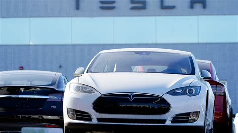 High-flying Tesla stock takes a hit on 1st day in S&P 500 ...