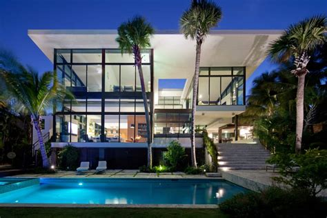 traditional street facade hides modernist home  miami lake
