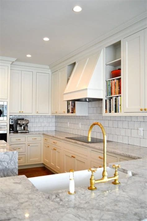 amazing kitchen features  white cabinets paired