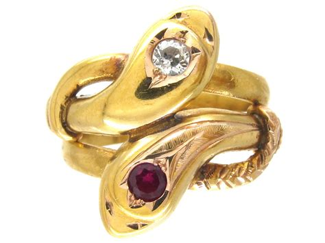 18ct gold double snake ring with a ruby diamond the jewellery company