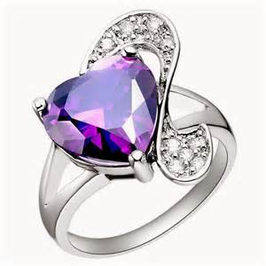 engagement rings with purple diamonds stock journal