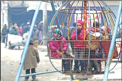 children play  waiting   evacuated     rebel held sector  eastern