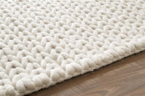 white woven rug texture in the front room shades of blue interiors