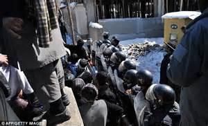 Afghanistan Koran burning protests: Effigy of 'Black Dog ...