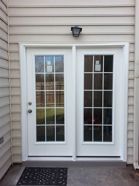 smooth fiberglass patio door with impact resistant glass