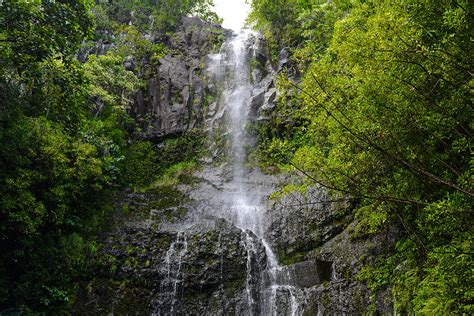 The road to hana, also known as the hana highway, is one of maui's most popular scenic drive featuring scenic views of tropical rainforests, waterfalls and black sand beaches. Waterfall in Maui Hawaii along the Road to Hana Photograph ...