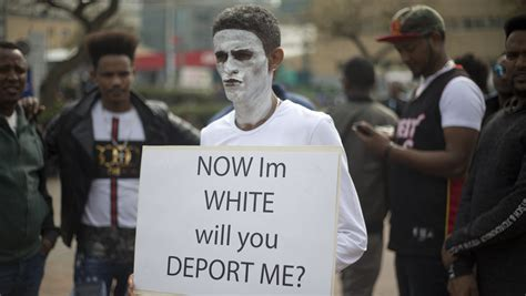 migrants israel african faces sudan protest deportation eritrea painting stop deporting africa israeli face paint qz them protests war government