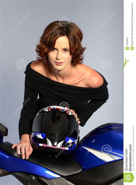 brunette girl  motorcycle black dress  helmet stock