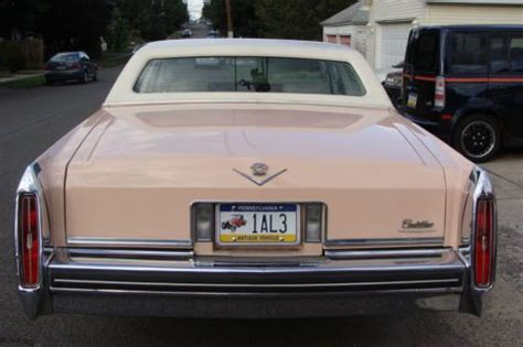 sell   pink cadillac deville base coupe  door