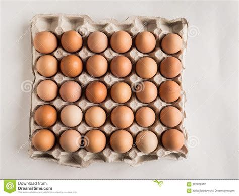 The first thing to do with expired eggs is give them a float test. A Lot Of Eggs In The Package. Stock Photo - Image of food ...