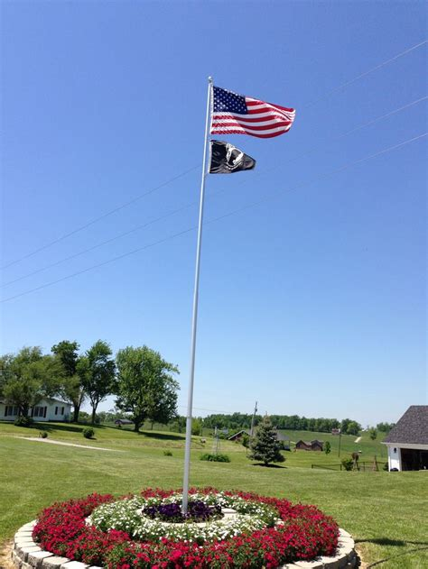 yard flag pole best 25 flag pole landscaping ideas on 1204