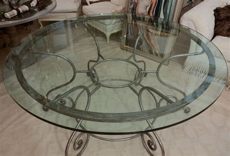 Round Glass Top Dining Table with Attractive Wrought Iron