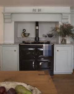 beautiful log home interiors classic cabinetry surround a classic black aga