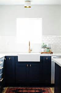 Delta Champagne Bronze Bathroom Faucet by Navy Shaker Kitchen Cabinets With Brushed Brass Knobs