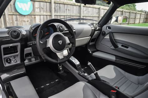 tesla roadster interior record breaking tesla roadster heads to auction wisely sold