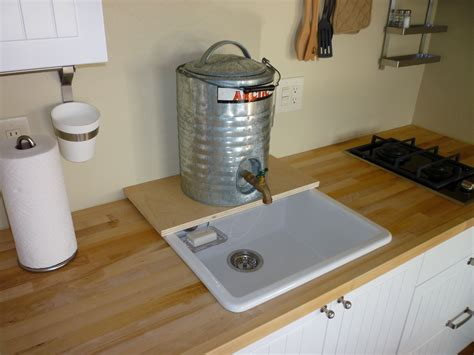indoor no plumbing sink kitchen with temporary plumbing tin can cabin