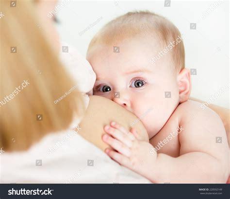 Mother Breastfeeding Her Baby Girl Stock Photo 220592149