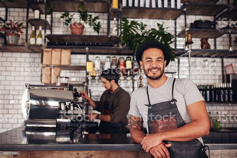 Male Coffee Shop Owner Standing At The Counter Stock Photo ...