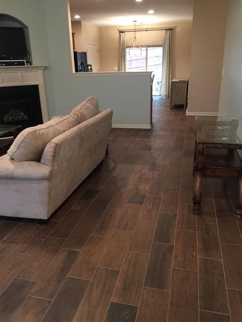 Replacing Hardwood Floors With Tile by Replace Carpet With Wood Look Tile