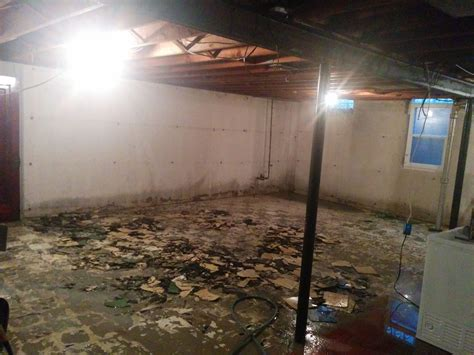 broken asbestos tile hosed   water  prevent dust