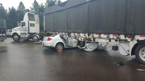 Driver Seriously Injured When Car Hits Semi Trailer
