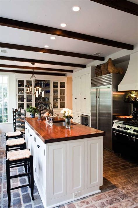 brick floors are what i notice first warm wood countertop