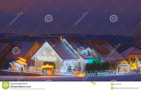 houses decorated with lights royalty free stock