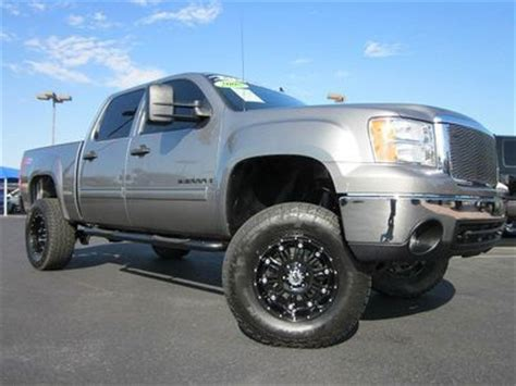 find   gmc sierra  crew cab slt  usedrcdkmclifted trucklow milesnice