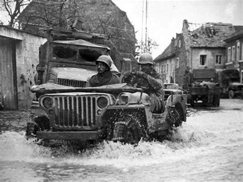 wwii jeep willys an allied willys jeep seen sloshing through water with