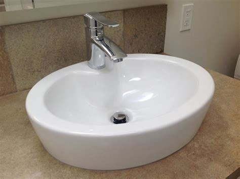 oval bathroom vessel sink white porcelain sits on counter