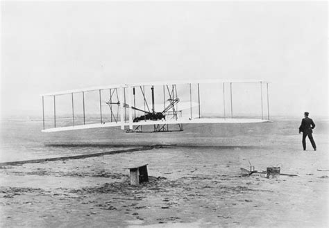 Image result for powered airplane flight took place near Kitty Hawk, NC. Orville and Wilbur Wright made the flight.
