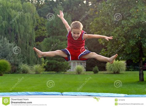 Boy Jumping On Trampoline Stock Photo. Image Of Laugh