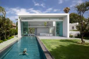 sleek cubic house with front and back gardens - Front To Back Split Level House Plans