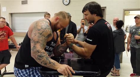 An arm wrestling champion vs. One of the strongest men in ...