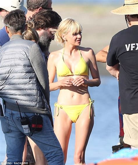 paul simon swimsuit anna faris dons a yellow bikini as she films overboard