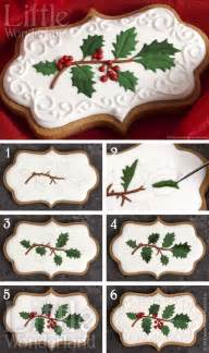 christmas cookies gingerbread cut outs with holly sprig design in royal icing looks like a