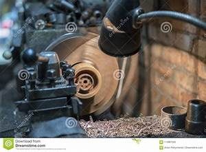 The Lathe Machine Cutting The Steel Rod In The Light Blue