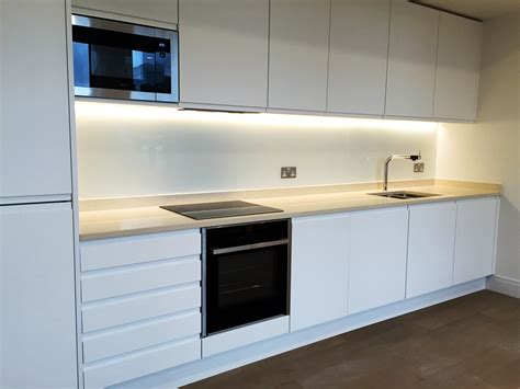 white kitchen with green glass splashback finishes glass outlet 2105