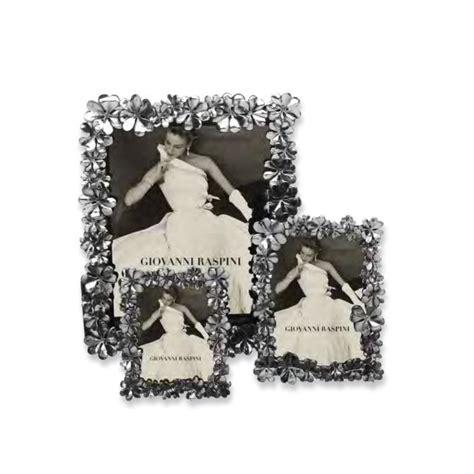 cornice raspini cornice raspini in bronzo bianco con quadrifogli