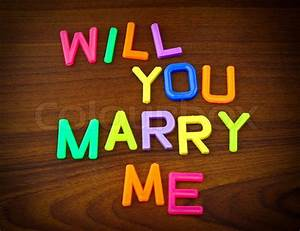 Will you marry me in colorful toy letters on wood for Will you marry me wooden letters