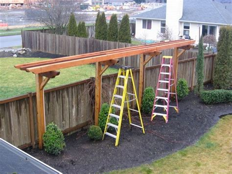 trellis design fence ideas with trellis love this idea then hang tomatoes or flower pots from it while there