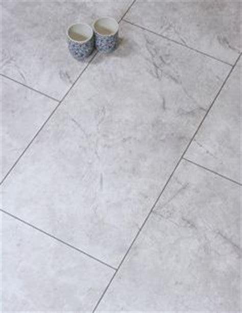 Egger Onyx Natural Tile effect laminate flooring in brown