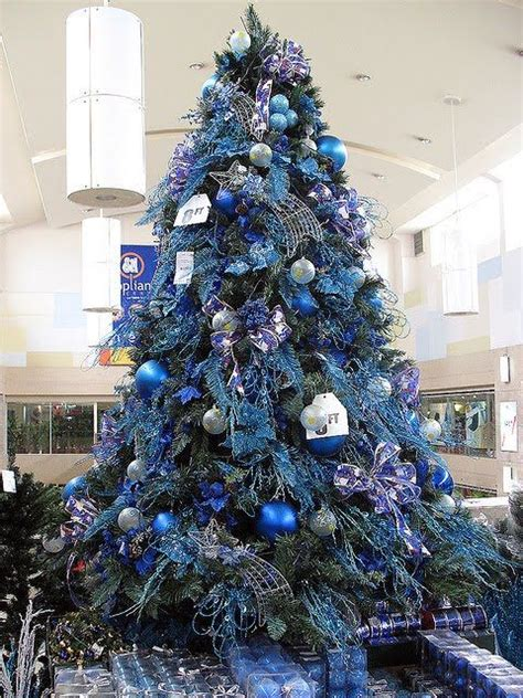 blue and silver cone christmas tree this tree has a royal blue and brown theme are mixed with oversize pine cones