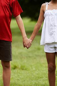 Children In Love Boy And Girl Holding Hands Stock Photo ...