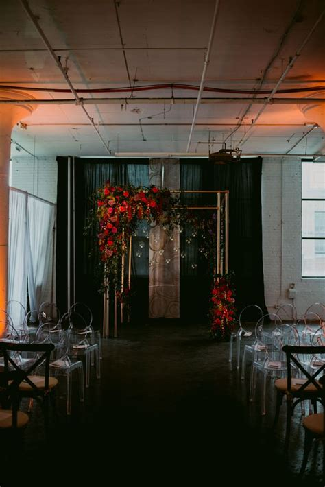 picture   copper wedding arch  lush red blooms