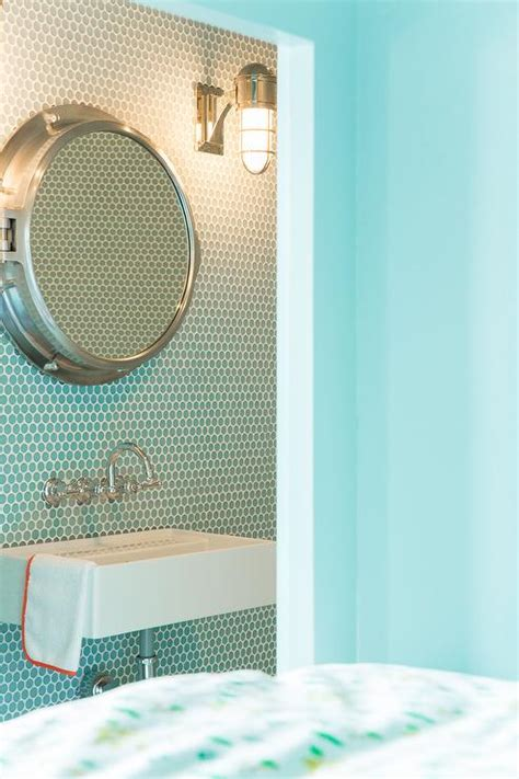 blue kids bathroom with turquoise penny tiles and royal