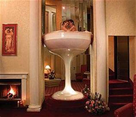 poconos glass tub caesars pocono resorts in room chagne glass tub
