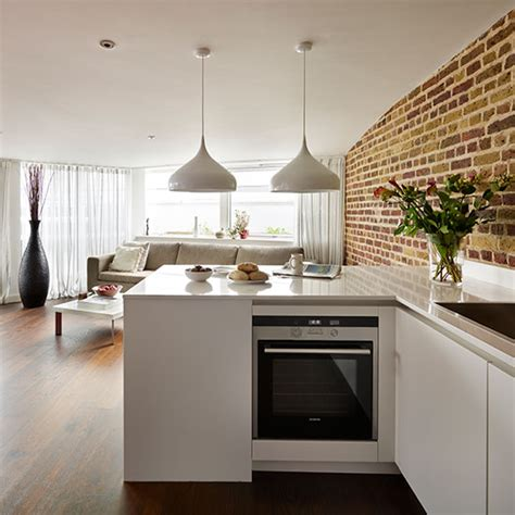 open plan white wood kitchen white open plan kitchen with brick wall decorating ideal home
