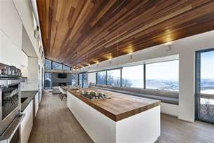 kitchen island with dining table modern ski chalet in serves as the ideal family retreat