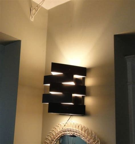 modern black abstract triangle in wall light fixture